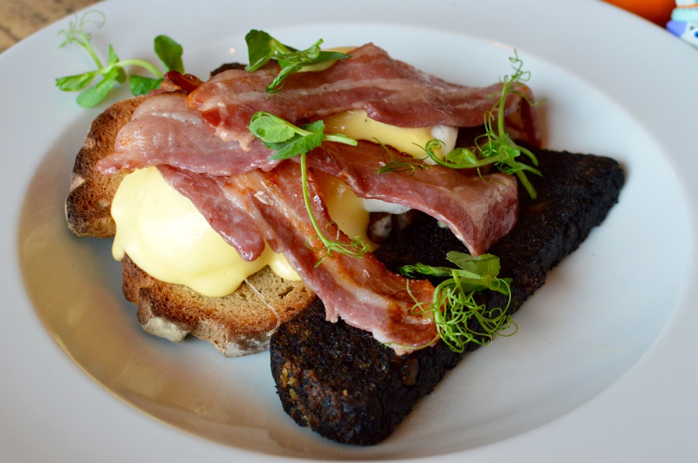 Poached eggs, toasted sourdough, crispy bacon, hollandaise + black pudding