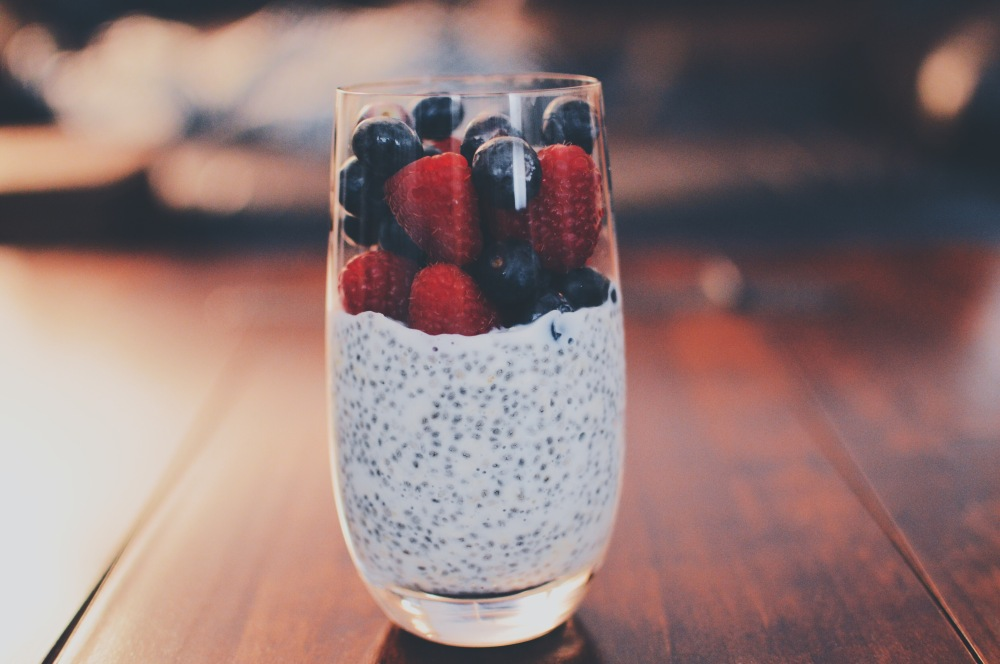 Chia pudding, almond milk, rapsberries and blueberries