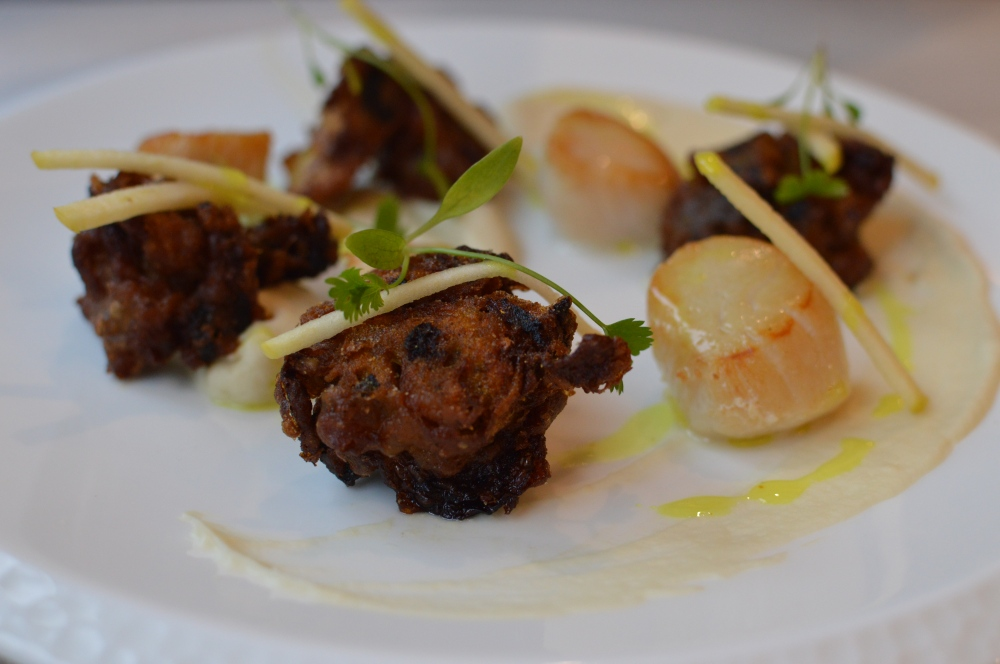 Pan fried scallops, black pudding bhaji, cauliflower puree, curry oil. Branches Ponteland.