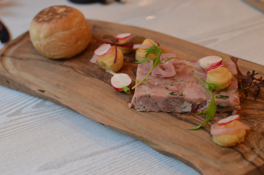 Terrine of ham hock, pease pudding, pickled shallots, warm stottie bread. Branches Ponteland.